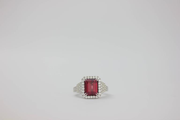One of Kind Fine Fine Rhodolite Garnet Ring set in 18K White Gold, adorned with white diamonds.  Rhodolite Garnet 4.83 Carats Diamond Count 64 Diamond weight: 0.74 Carat
