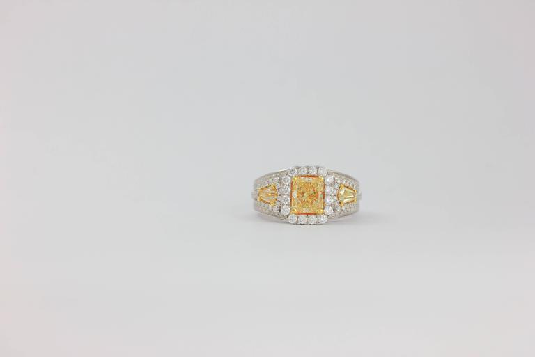 18K WG 3-STONE YELLOW DIAMOND ONE OF KIND RING   Radiant Center 1.30 CARAT Side Yellow Diamonds  0.48 CARAT Diamond Count 114 White Diamond Weight  0.88 CARAT