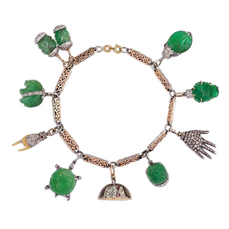 Art Deco Carved Emerald and Diamond Charm Bracelet in Gold and Platinum