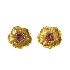 A Pair of 1940s Ruby Diamond Gold Platinum Flower Brooches