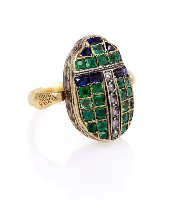 deco gold ring with antique gemset scarab at