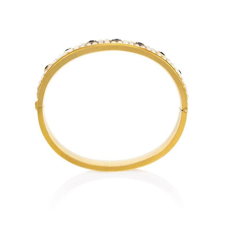 Victorian Antique Half-Pearl Sapphire Gold Bangle Bracelet For Sale