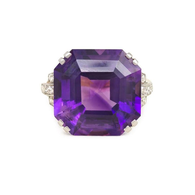 A Retro cocktail ring centering on a large octagonal amethyst, with diamond-set shoulders and openwork mount, in 18k gold and platinum.  Top approximately 5/8x5/8""