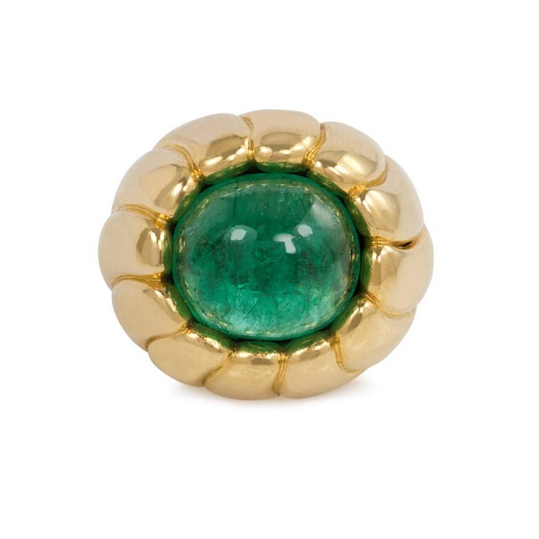 A Retro fluted gold and cabochon emerald cocktail ring of bombé design, in 18k.  Cartier, Paris #05148.  Approximately 9.04 ct. emerald  Current ring size: 4.25; minimal re-sizing possible