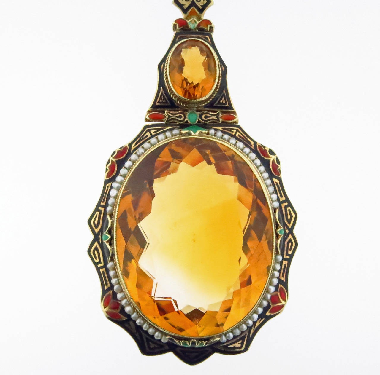 Exciting 14kt. yellow gold faceted natural citrine necklace Egyptian inspired four color enamel in near perfect condition. The larger citrine weighs approx. 62.cts. surrounded by natural seed pearls. The enamel chain measures 24 1/2