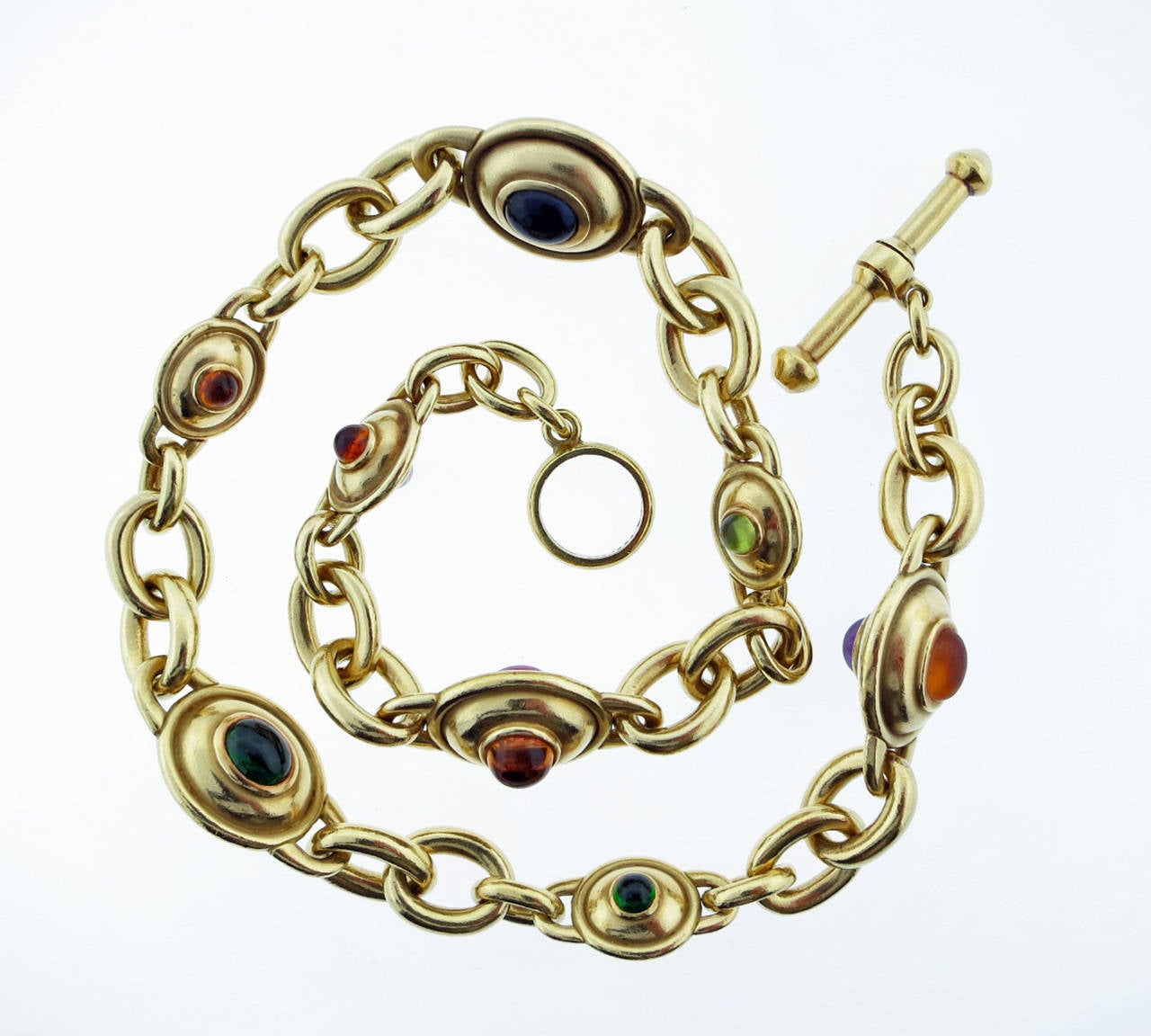 18kt. yellow gold Kieselstein - Cord toggle link necklace. The  double sided links are bezel with a mix of cabachon garnet, tourmaline, citrine, amethyst and peridot.The necklace measures 19 inches and weighs an ample 214.1 gr. Signed and dated 1984.