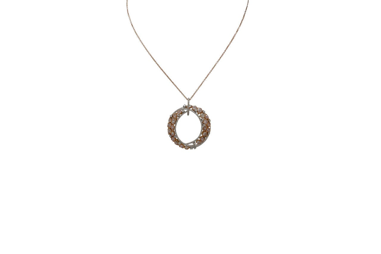 white and gold open circle pendant