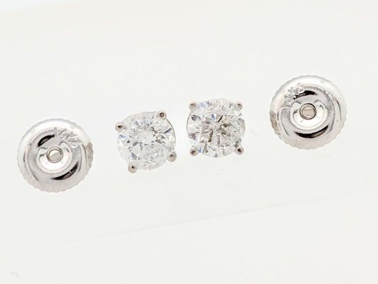 Contemporary 14 Karat White Gold Diamond Stud Earrings 75 Carat I1 I For