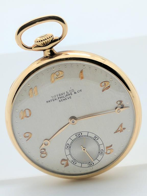 You are viewing one of the rare timepieces and collaborations from two of the most prestigious names in the jewelry and watch trade.  This stunning 1930's solid 18k yellow gold pocket watch was created by Patek Philippe for Tiffany & Co.  The