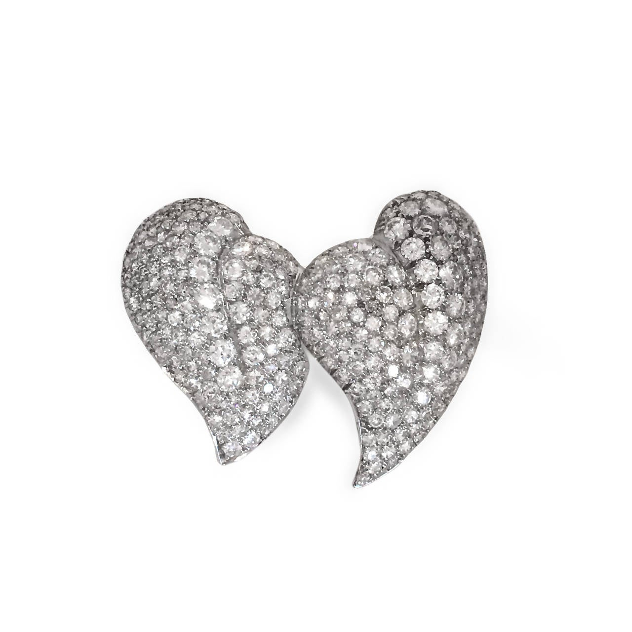 Platinum two finger double heart shaped ring for sale at 1stdibs