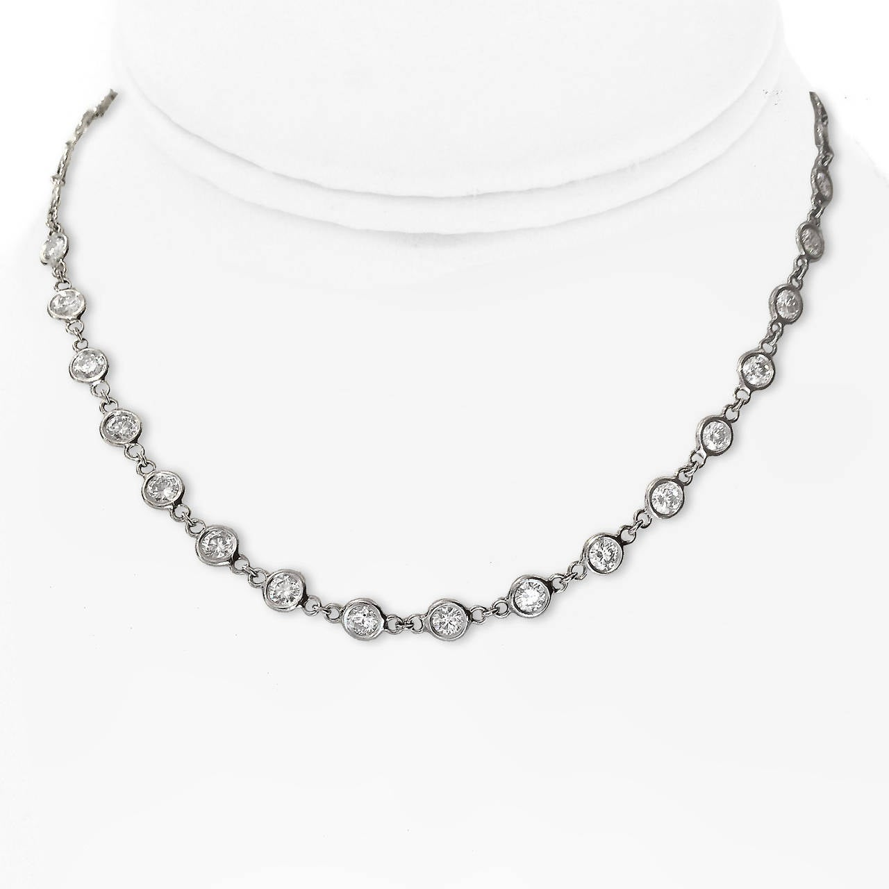 "Purely contemporary ... 39 round G color VS-VS2 grade diamonds, for a total of 7.77 carats, make this a WOW necklace. 16"" long."