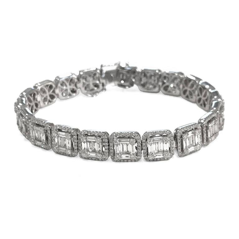 With over 120 baguettes, this 18k white gold bracelet is ablaze with diamonds. Features 80 brilliant-cut 1.15 carat stones, with 2.47 carats of smaller diamonds framing the larger gems. Over 8 carats in total, but crafted to look like 20! More than