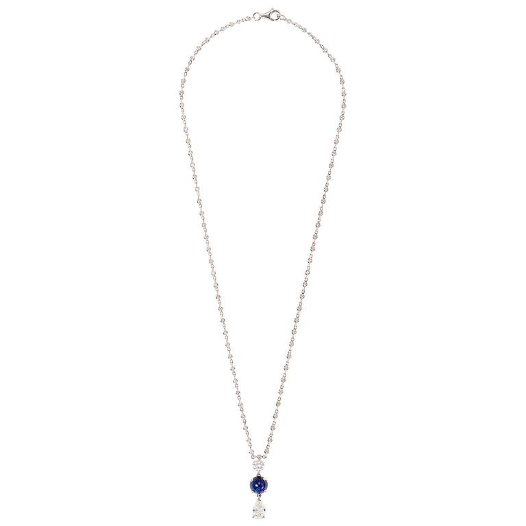 Original design by Mindi Mond, featuring a dangling pendant with a .91 ct bullet-shaped pear diamond ( G, VS) hanging from a 2.4 ct cabochon sapphire in the center, topped by a .30 ct. round-cut diamond. 18 inch 18k gold chain includes an add'l