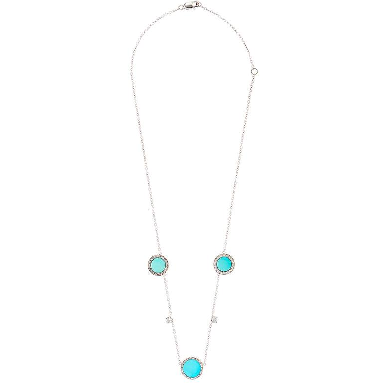 "Features three large turquoise pendants surrounded by old-cut diamonds, separated by two old mine-cut diamonds .16 each G-H SI, all in intricate platinum settings backed in gold. Platinum chain adjusts from 16"" to 18"". Reconceived by Mindi Mond from"