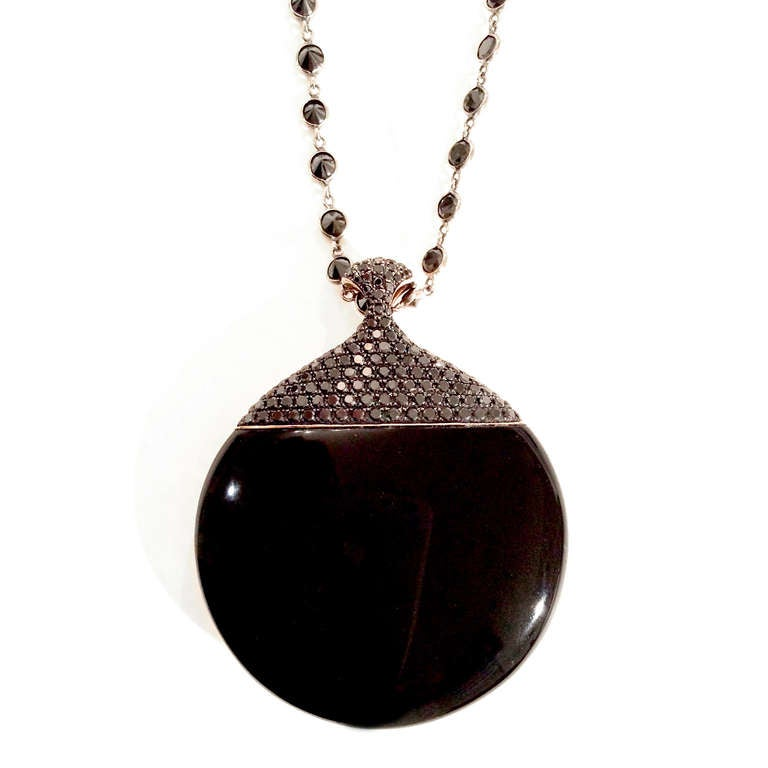 18k rose gold and onyx pendant, with matching 25 carat black diamond chain of 18k blackened gold. One side of the pendant features the rich, timeless look of metal and stone together. Reverse the pendant, and enjoy the setting's approximately 1.72