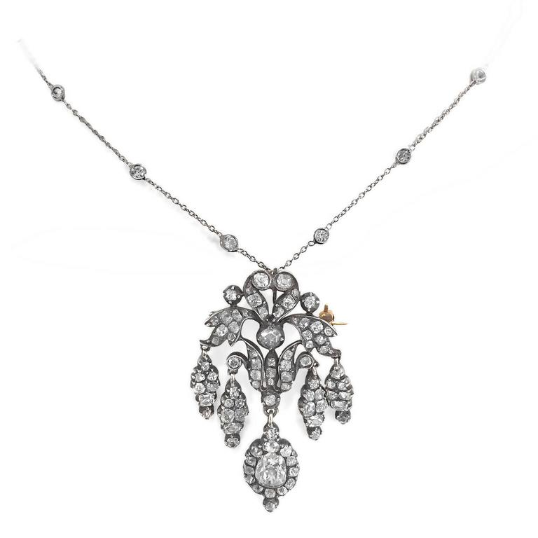 """Outstanding original Victorian 4 carat old mine-cut diamond convertible pendant/brooch from 1870. Yellow gold and silver, true to the Victorian period. 18 inch chain is .68 carat diamond and platinum. Pendant is just under 2"""" long. Larger .95"""