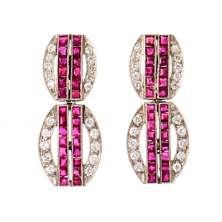 Straight from the 1930s and reconceived by Mindi Mond, these platinum diamond and ruby dangle earrings include approx. 0.80carats of diamonds, plus approx. over 1.00+ carats in princess-cut rubies. Originally from the Deco period, redesigned in 2017