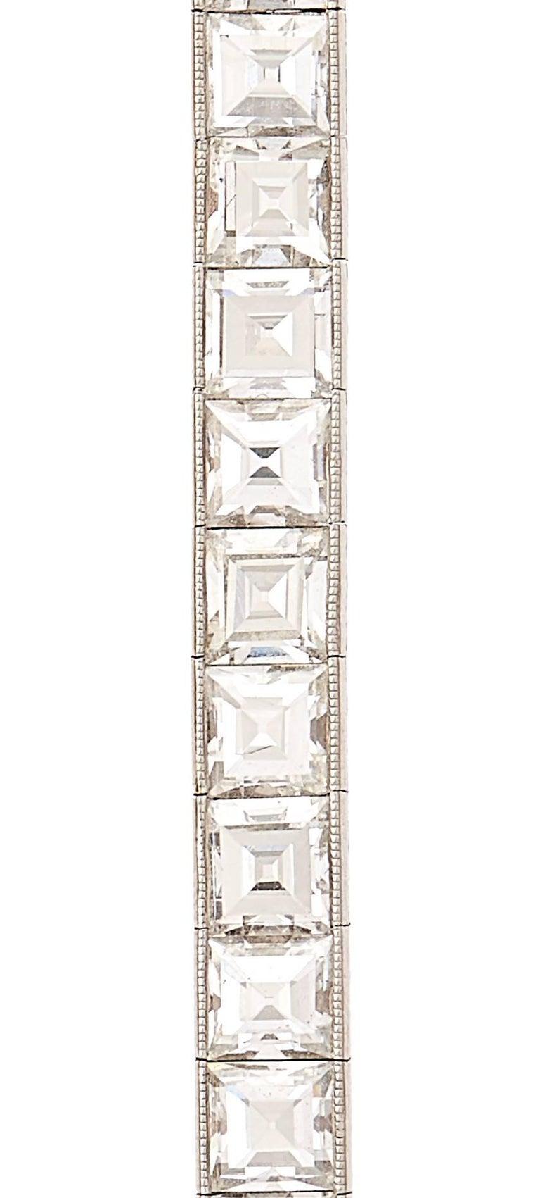 Art Deco 14 Carat Emerald Cut Diamond Platinum Line Bracelet In Excellent Condition For Sale In New York, NY