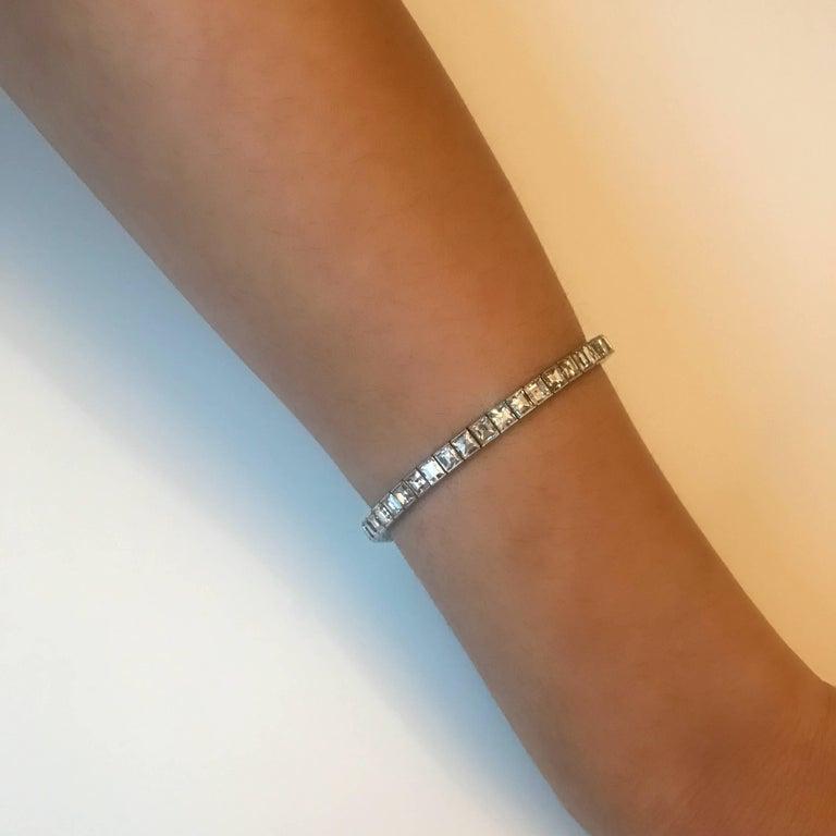 Art Deco 14 Carat Emerald Cut Diamond Platinum Line Bracelet For Sale 1