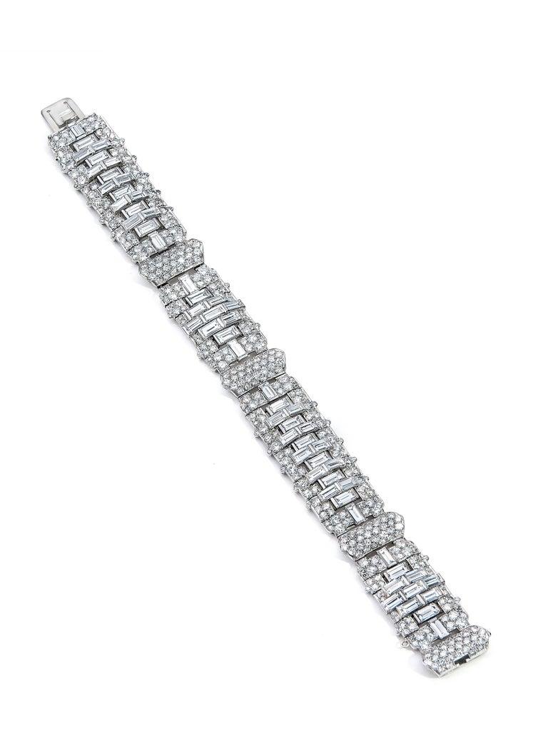 Spectacular Art Deco Design! Outstanding Quality and Craftsmanship! Approximately 24.5 carat Diamonds. E-F, VVS-VS 58 straight Baguette Diamonds. 318 Round Brilliants. (Old European) & 76 round single cuts. 7