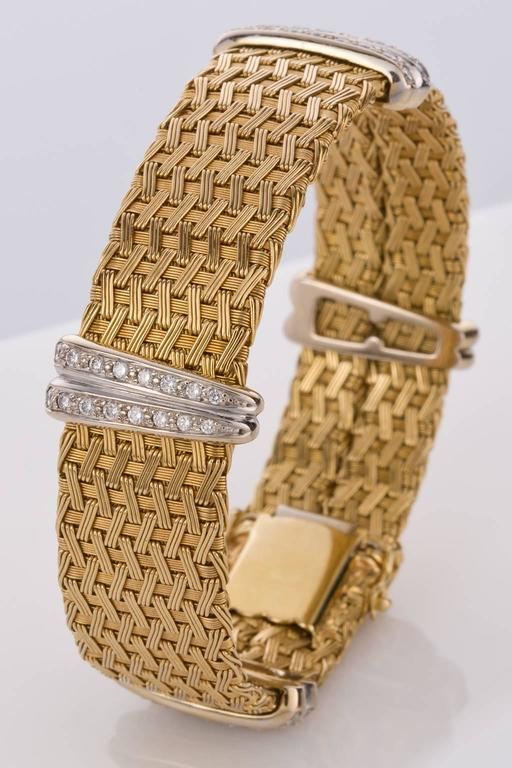 A truly sensational finely crafted German woven mesh flexible link bracelet in 18ct yellow gold, set with four white gold feature strips showcasing 64 grain set white modern brilliant diamonds weighing approximately .80cts. Diamonds are graded as H