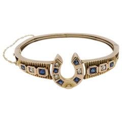 9 Karat Yellow Gold Diamond and Sapphire Horseshoe Bangle