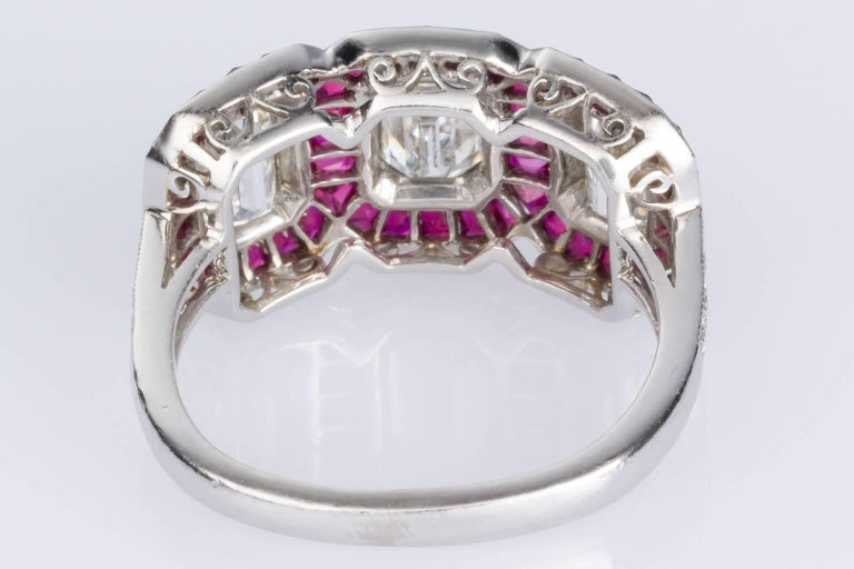 Art Deco 1.95 carat Emerald Cut Diamond and Ruby Platinum Engagement Ring For Sale