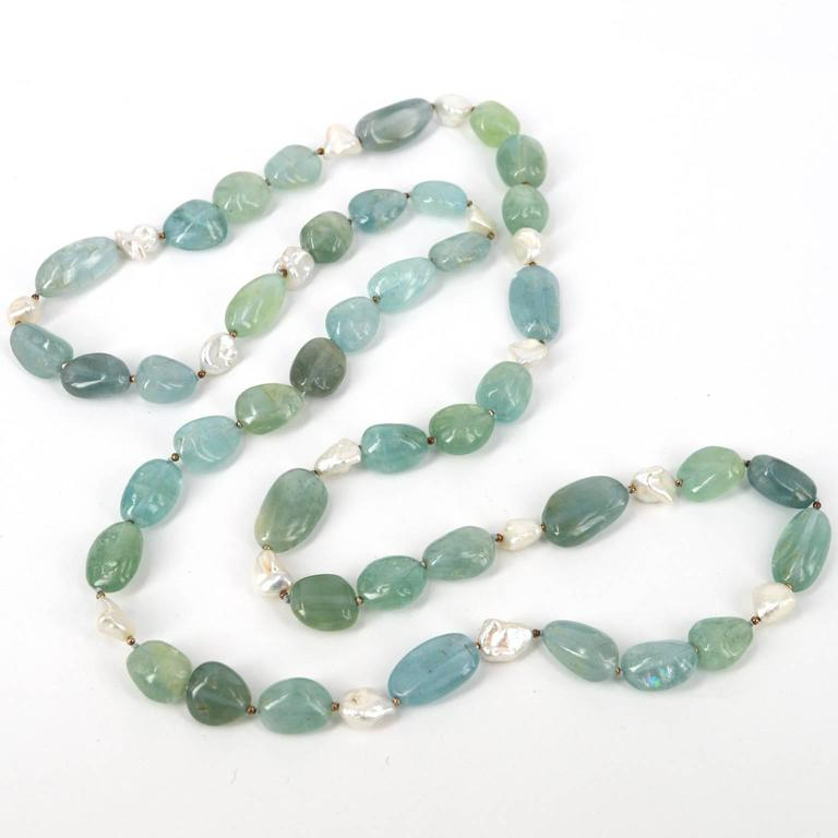 Blue, Greens and Aquas of this natural Aquamarine nugget hand knotted necklace are spaced with 16 x 10mm Keshi Fresh Water Pearls and spaced by oxidised 2mm Sterling Silver beads. Aquamarine nuggets range from 12x15mm up to 12x24mm. All stones are