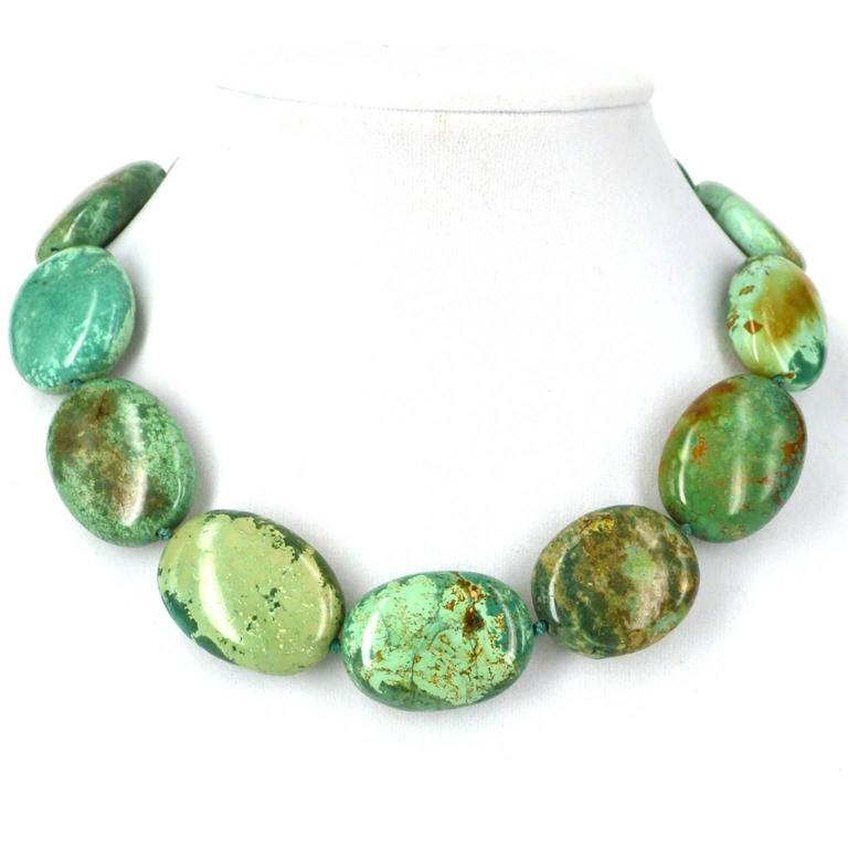 Large Polished nuggets of Stabilised Natural Chinese Turquoise with an elegant Sterling silver hook clasp hand knotted on Teal coloured thread. Nuggets range from 27-34mm Finished Length 42cm