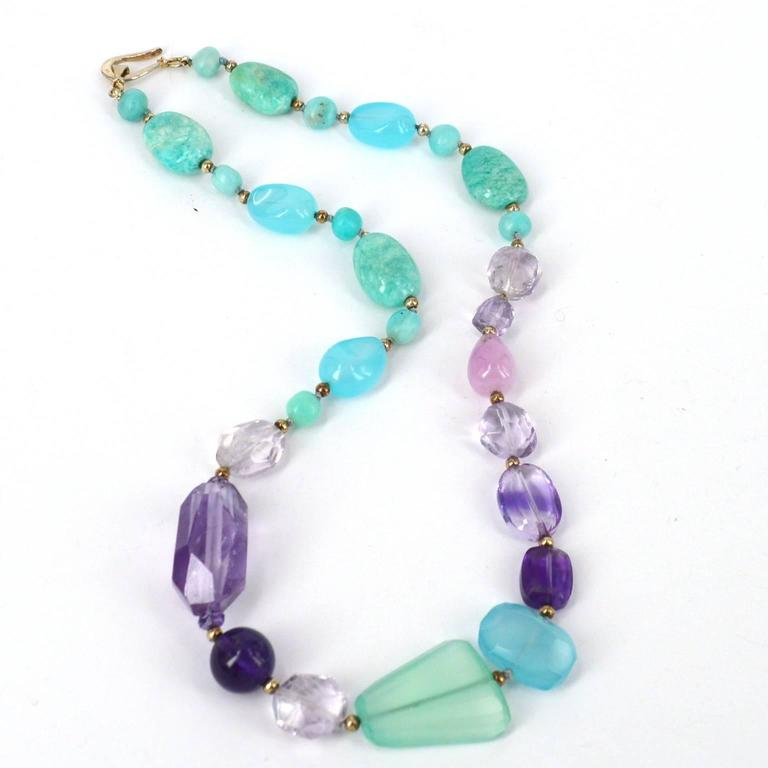 Aqua and Purple mix in together delicately in the pretty necklace. Stones are a beautiful mix of Peruvian Amazonite, Chalcedony, Kunzite and Amethyst spaced with oxidised 3mm Sterling silver beads. Necklace has been hand knotted on pale aqua