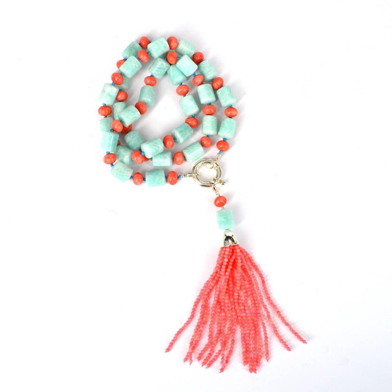 Gorgeous pastels of 13mm Amazonite tubes and 7mm dyed bamboo coral roundels, 2mm coral beads create the  removable tassel. The necklace is finished with a large Sterling Silver bolt clasp. 72cm Necklace with a detachable tassel pendant 12cm long.