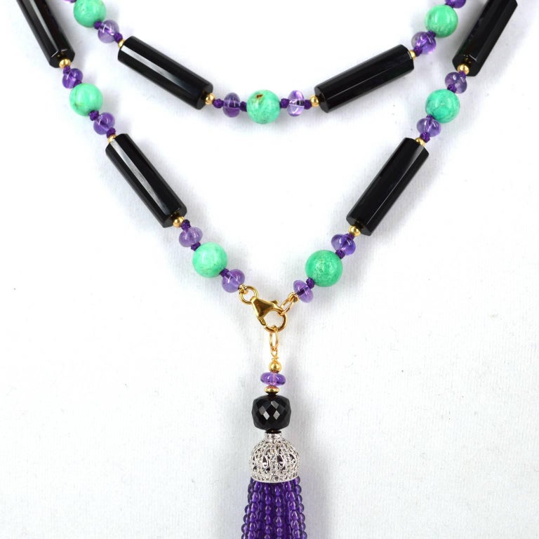 Stunning Sautoir Necklace with detachable tassel, necklace is made from faceted Onyx tubes 7x24mm and is spaced with 3mm 14k Gold Filled beads 6x4mm polished Amethyst roundels and 8mm Australian Chrysophase, hand knotted on purple thread. Detachable