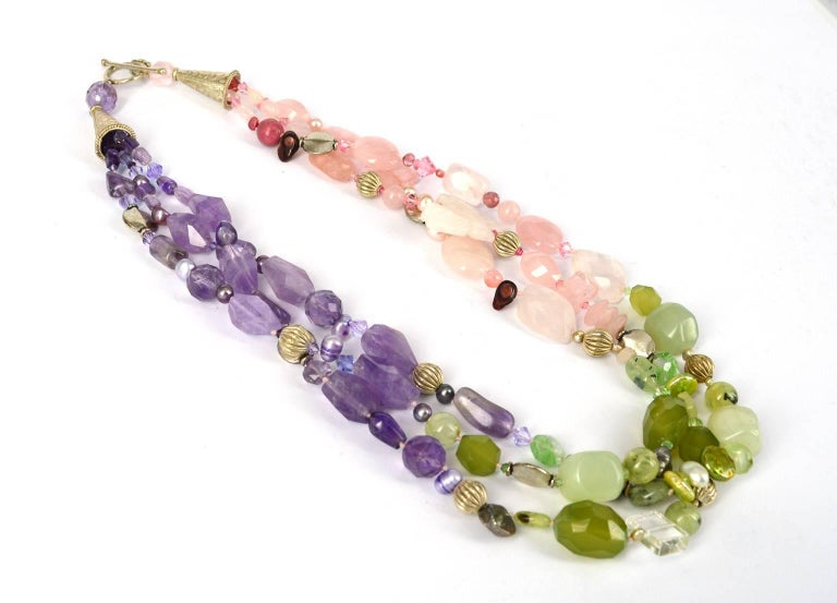 3 Strand torsade Necklace made up of various shapes and stones. Rose quartz swarovski freshwater pearls prehnite chalcedony amethyst and silver plated copper. 56cm in length