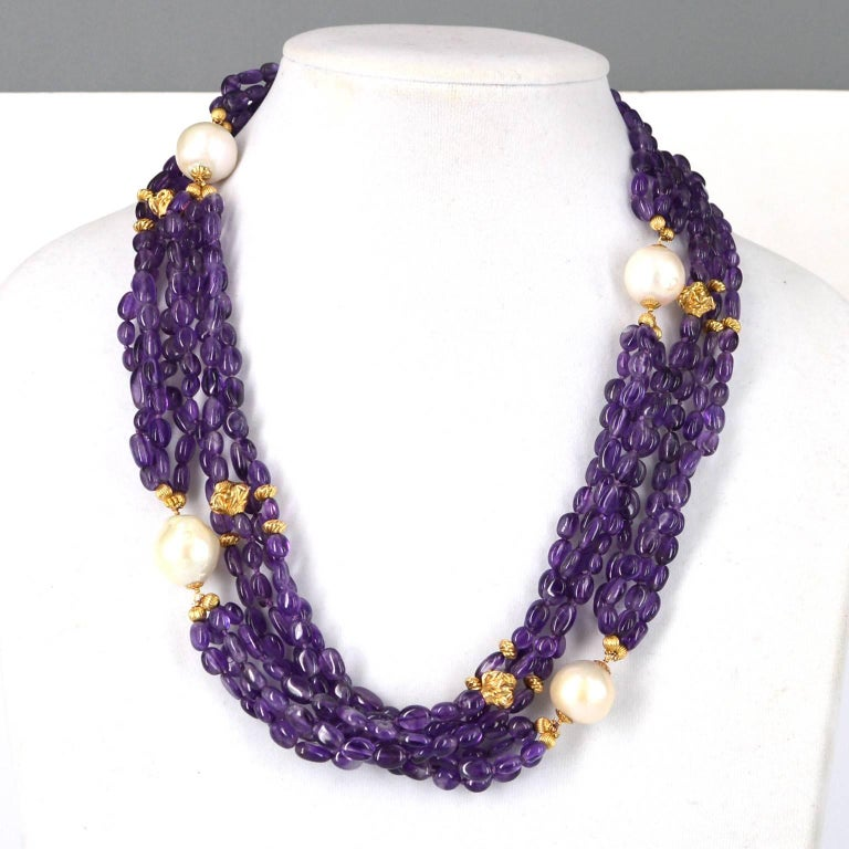 Small polished nuggets approx 7x5mm of dark Amethyst beads, hand knotted on purple thread in 4 strands each section separated by a large 17mm Fresh Water Baroque Pearl. 14k gold filled beads scattered throughout the design. 16mm vermeil ball