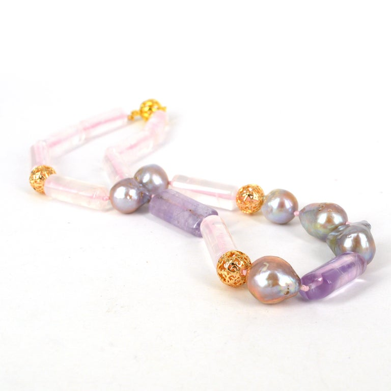 Statement Rose Quartz 10x28mm polished tubes with 14x24-30mm flattened Amethyst tubes, 6 16+mm naturally pink Fresh Water Pearls, 3x12mm filigree 14k Gold filled beads, hand knotted on pink thread with a 13mm Gold plate Sterling Silver clasp  Total