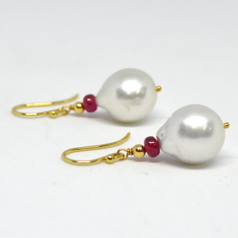 Natural Brazilian Rubies 3x4mm with 15x12.7mm high sheen South Sea Pearls set on 9ct yellow Gold Sheppard,  14k Gold head pin and 3mm round bead.  Total Earring length 36mm.