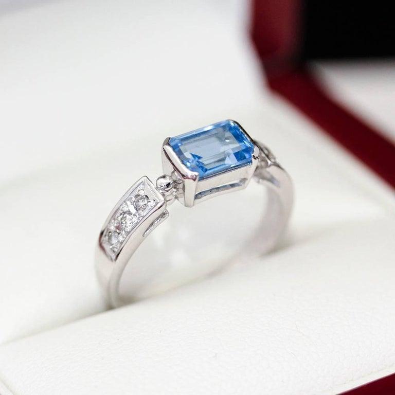 emerald cut blue topaz white gold