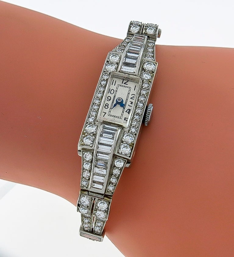 This magnificent lady's platinum watch is set with sparkling baguette and round cut diamonds weighing approximately 2.45ct. The color of these diamonds is H with VS clarity. The bezel of the watch measures 1.53in. by 0.66in. and will fit a standard