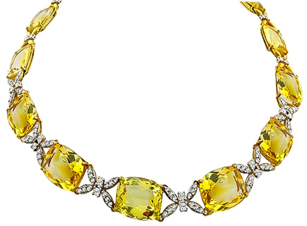 Made of 18k yellow and white gold, this set features cushion and oval cut citrines weighing approximately 90.00ct. The citrines are accentuated by sparkling round cut diamonds weighing approximately 3.50ct.The necklace measures 12mm in width and 16