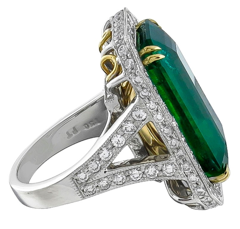Made of platinum & 14k yellow gold, this ring centers an emerald cut emerald that weighs 17.75ct. The emerald is accentuated by sparkling round cut diamonds weighing approximately 2.50ct. The ring is size 6 1/4, and can be resized.