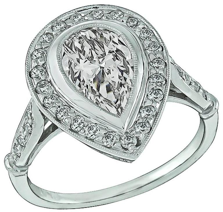 1.08 Carat GIA Cert Pear Shape Diamond Platinum Halo Engagement Ring For Sale