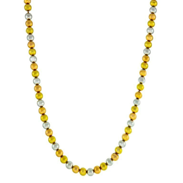 Made of 18k yellow, rose and white gold beads, this necklace features a smooth gold finish. The necklace measures 16 3/4 inches in length and weighs 37.6 grams. It is stamped 750.