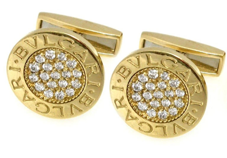 Made of 18k yellow gold, these cufflinks feature sparkling round cut diamonds that weigh approximately 1.15ct. graded E color with VVS clarity.  The cufflinks measure 15mm in diameter and weighs 13.2 grams.  Each of the cufflinks is triple signed