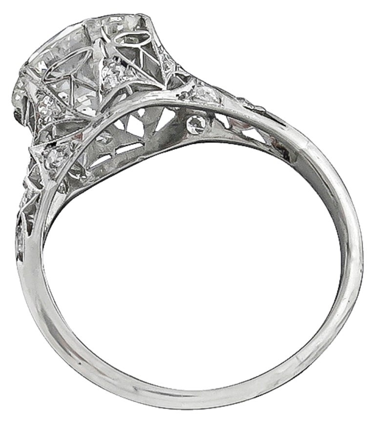 This stunning platinum ring from the Edwardian era, centers a sparkling GIA certified round brilliant cut diamond that weighs 3.61ct. The color of the diamond is J with SI1 clarity. The center diamond is accentuated by dazzling round cut diamonds