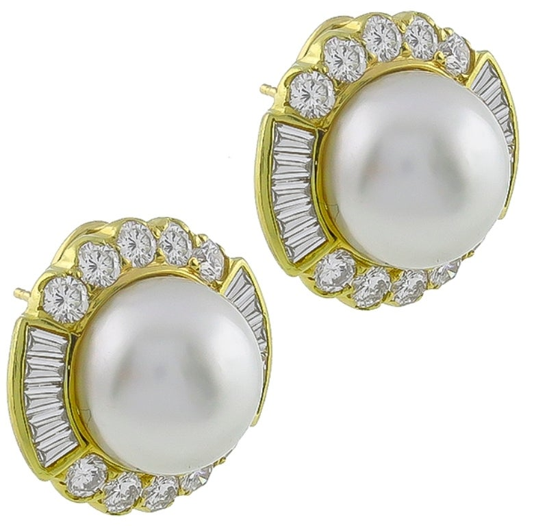 This gorgeous pair of 18k yellow gold earrings, feature lovely mabe pearls. The pearls are accentuated by sparkling round and baguette cut diamonds that weigh approximately 4.00ct. graded F color with VS1 clarity. 