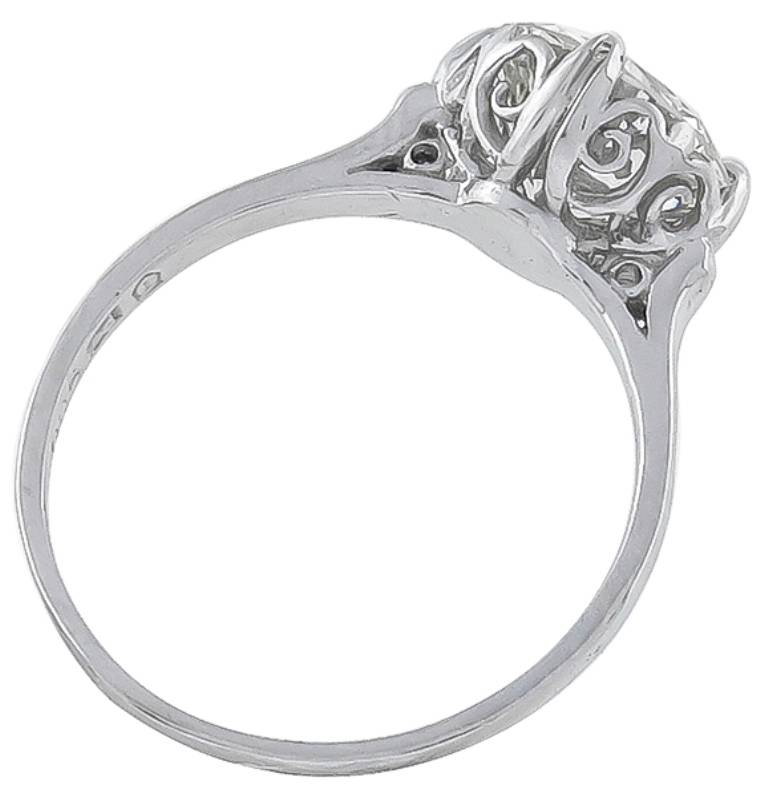 This platinum ring inspired from the Edwardian era, centers a sparkling round brilliant cut diamond weighing 2.01 carat, graded J color with VS1 clarity. 