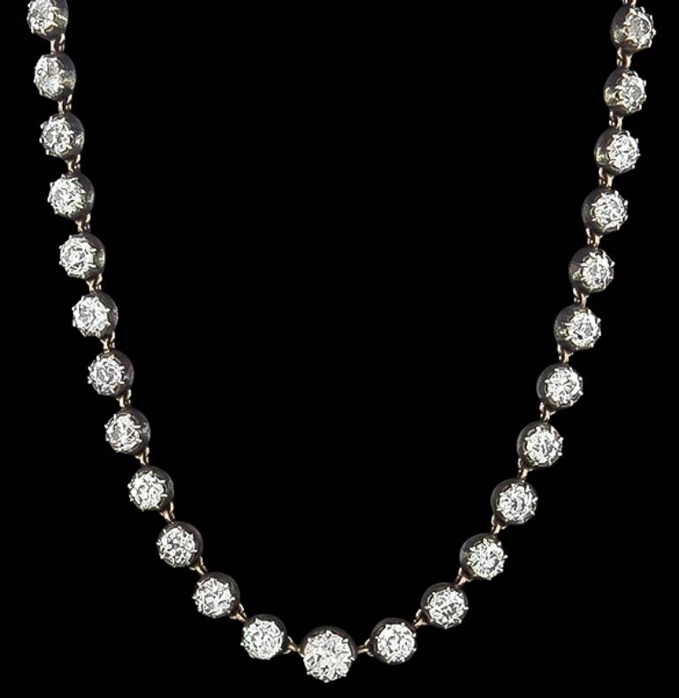 This necklace is set with 42 sparkling old mine cut diamonds that weigh 28.60 carat. The color of the diamonds range from G-J with VS1-SI1 clarity. The necklace measures 9mm at the widest base and weighs 45.5 grams.  Inventory #85036NAASS