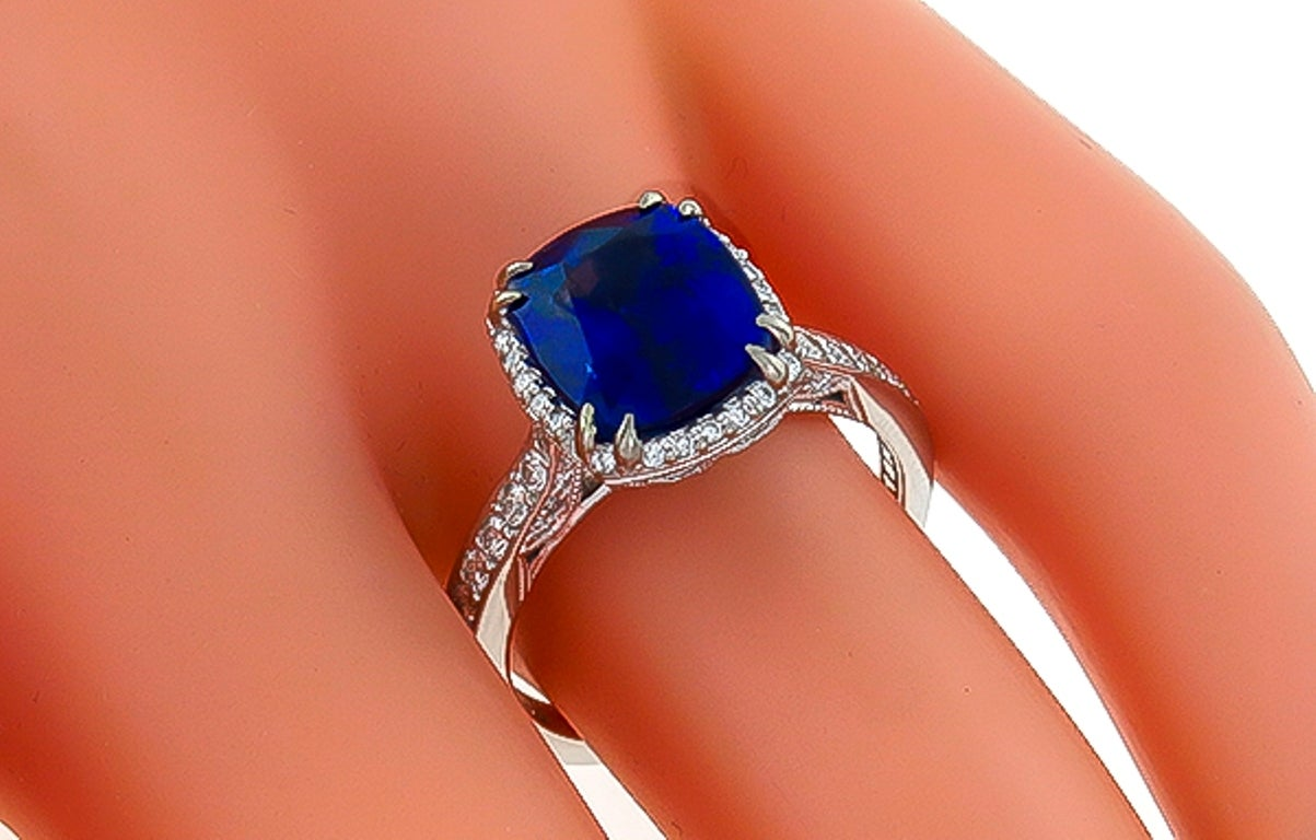 Made of 18k white gold, this ring centers a vivid blue cushion cut Ceylon sapphire that weighs 3.87ct. The center stone is accentuated by sparkling round cut diamonds weighing approximately 0.80ct.