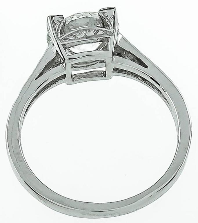 This stunning platinum ring is centered with a sparkling GIA certified old mine cut diamond that weighs 1.64ct. graded J color with SI1 clarity. The ring is stamped PLAT and weighs 3.9 grams.