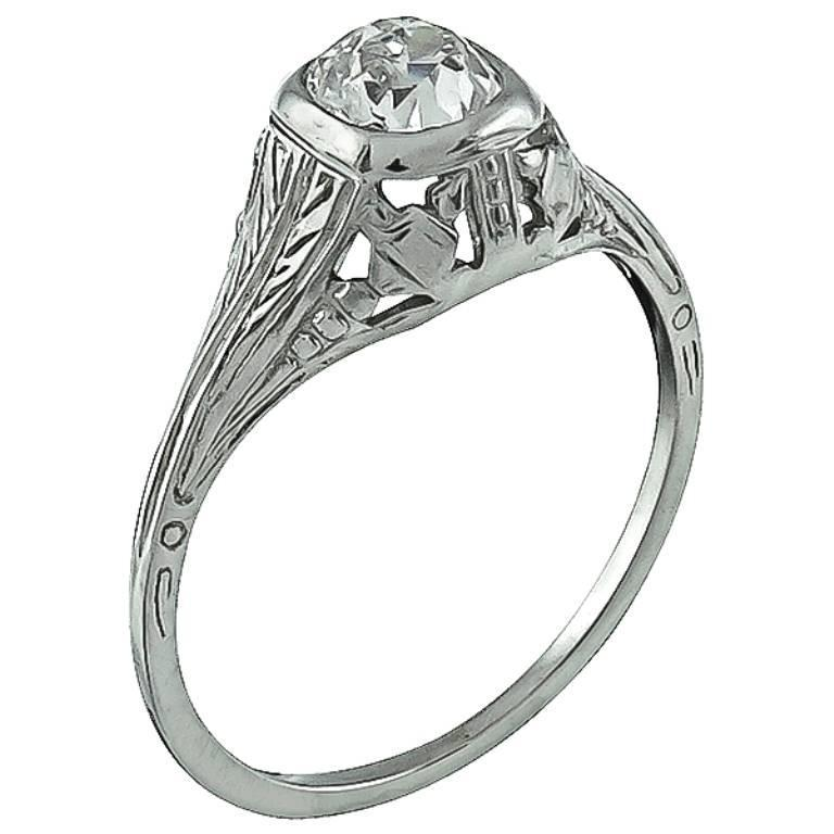 This beautiful 18k white gold ring is centered with a sparkling GIA certified old European cut diamond that weighs 0.54ct. and is graded I color with VS2 clarity. The ring is stamped 18k and weighs 1.6 gram. It is currently size 5 1/2, and can be